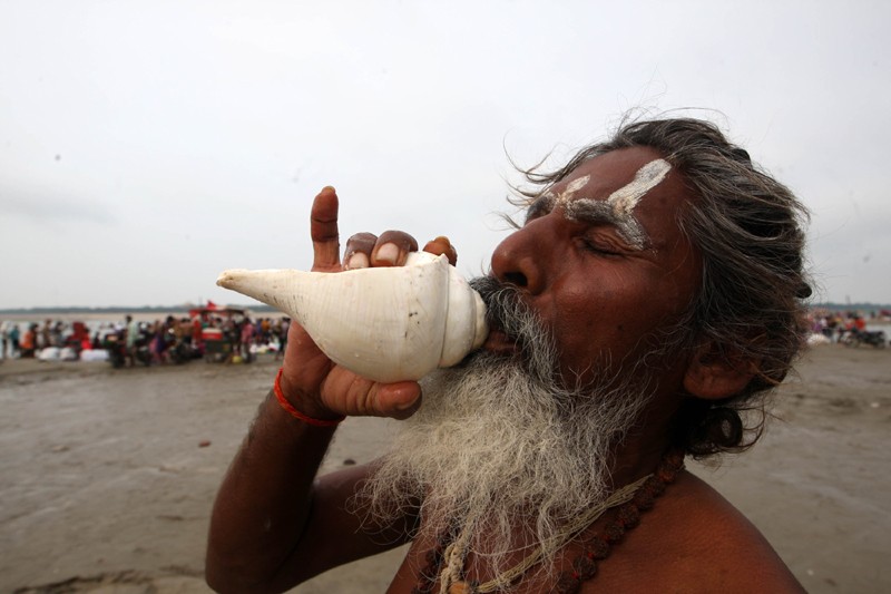 Sadhu praying after taking holy dip at Sangam in Prayagraj on Ganga Dussehra