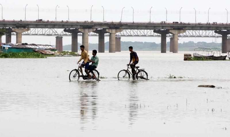 Prayagraj: Boys cycling in the flood water of Ganga