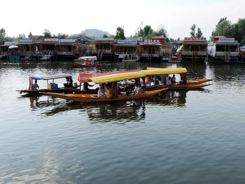 Tourists taking a shikara ride in Srinagar's Dal Lake