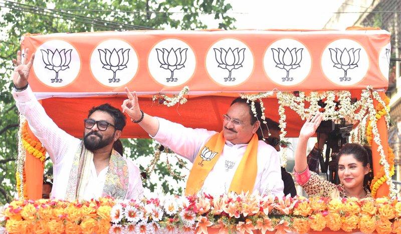 J P Nadda waving supporters during road show for Babul Supriyo in Kolkata