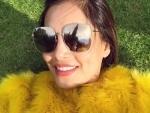 Bipasha Basu lies on green grass, feels immensely happy