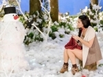 Sunny Leone shares cute image of herself knitting scarf for snowman