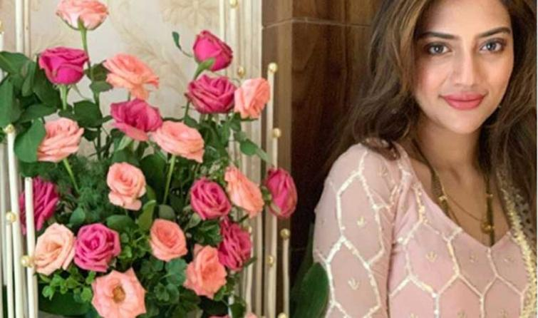 With a bouquet of rose by her side, Nusrat Jahan looks gorgeous in her latest Instagram photo