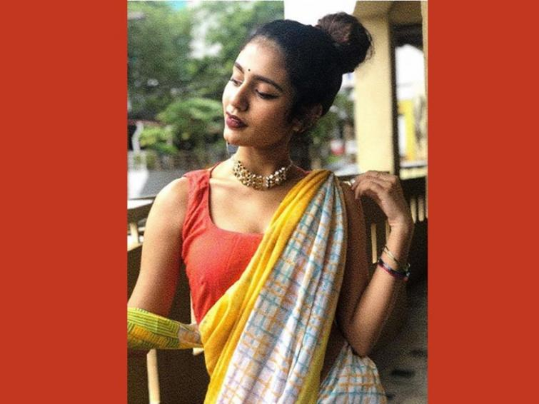 Wink Girl Priya Varirer is back to win hearts by posting her image in traditional sari avatar