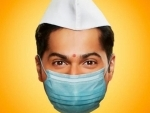 In new Coolie No.1 poster featuring Varun Dhawan, makers gives a surprise COVID-19 twist to fans