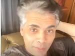 Karan Johar shows off his 'grey hair' look during live chat with Varun Dhawan