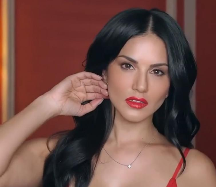 Sunny Leone looks stunning in her latest video, seen sporting red strap dress