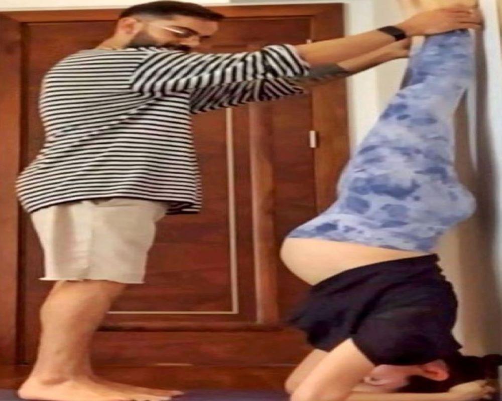 Pregnant Anushka Sharma does yoga with Virat Kohli's help