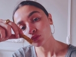 Alia Bhatt looks stunningas she poses before the camera with French fries in her hand