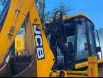 Sunny Leone jumps up on a JCB, shares funny image on social media