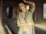 Mouni Roy scorches social media with open button olive green shirt pictures