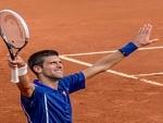 ATP World Tour Finals: Novak Djokovic beats Raonic to reach semis