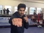 Vijender Singh beats Chinese opponent Zulpikar Maimaitiali, extends winning run