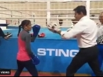 Union Sports Minister Rajyavardhan Singh Rathore engages in friendly out with Mary Kom