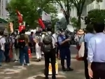 Protest against Olympic Games occurs in Tokyo near stadium during opening ceremony