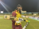Chris Gayle smashes 67 runs to help West Indies beat Australia in T20 clash, becomes first cricketer to score 14,000 runs in shortest format of cricket
