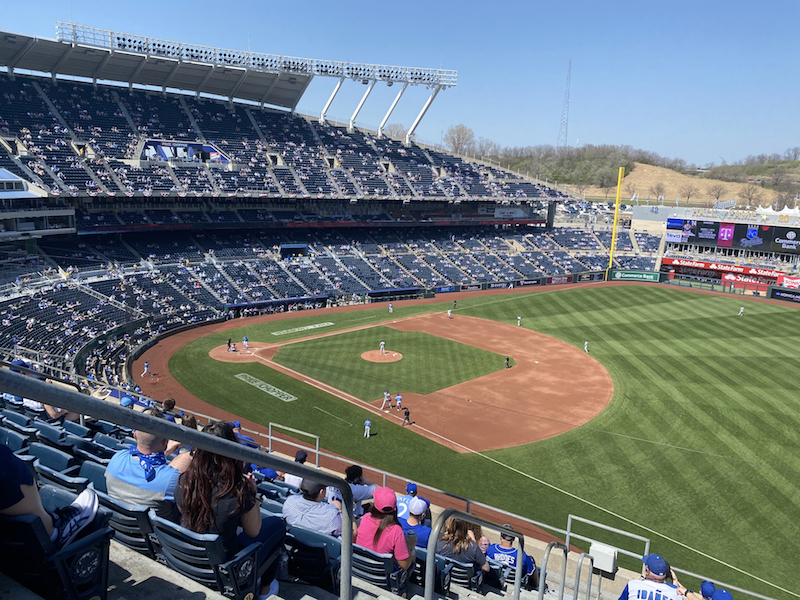 A socially distanced crowd of 10,000 people take in a game between the Texas Rangers and the Kansas City Royals on April 4, 2021, in Kansas City, MO. Image by Jackson Stone.