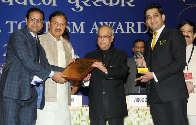 President of India Pranab Mukjherjee presents the national tourism awards