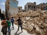Several killed in suspected missile strike on Syrian air base