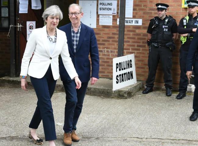 Amid criticisms, British PM Theresa May reshuffles cabinet