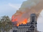 Notre Dame fire 'under control', French President Macron vows to rebuild it