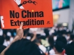 Hong Kong protests: Demonstrators sing and boo Chinese anthem