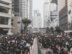 Hong Kong police use tear gas to disperse protesters in Mong Kok district - Reports