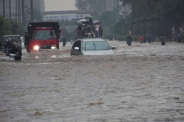 Twelve killed, nearly 15,000 flee home as floods, landslides hit western Indonesia