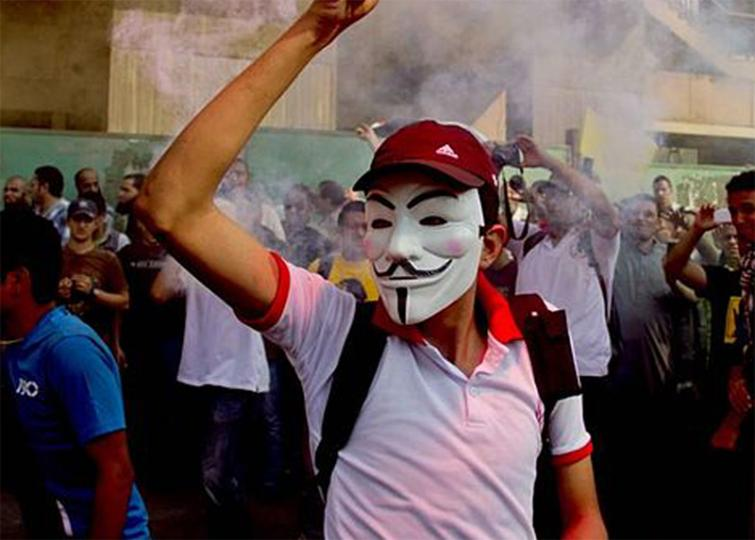 First two Hong Kong citizens charged under new law banning masks in protests