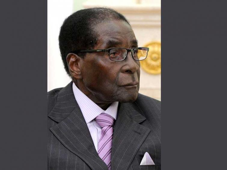 Zimbabwe's president cuts short South African trip after Mugabe's passing