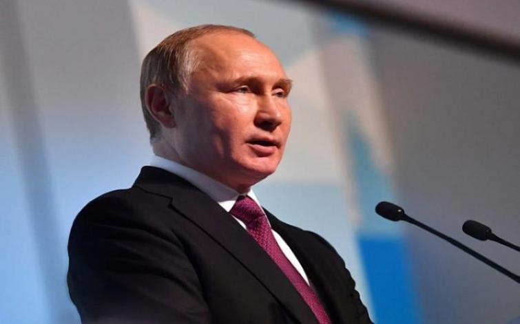 To work out response for unilateral sanctions, Putin calls on global community
