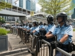 Apple Daily announces closure days after police crackdown