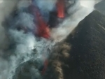 Thousands evacuated, houses destroyed as volcanic eruption in Spanish island enters 'new explosive phase'