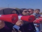 Taliban members use tear gas to disperse women rights rally in Kabul
