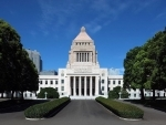 Japan's ruling opposition parties agree on bill for amending referendum law: Reports